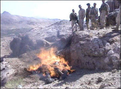 US soldiers watch Taliban bodies burn