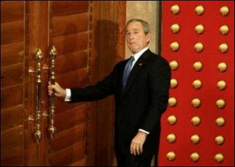 Dubya tries the door
