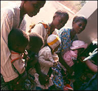 Waiting in line at a Zambia health clinic
