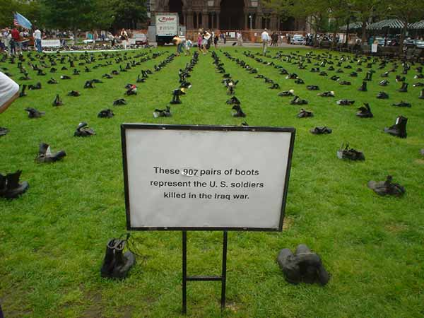 907 pairs of empty boots in a Boston park in July of 2004 commemorating the number of U.S. soldiers that had died in Iraq since the beginning of the war. - natasha