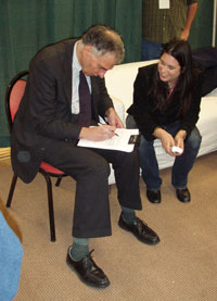 Ralph Nader with Leah of Current TV and a release contract at PowerShift07 - Natasha Chart, Nov 3, 2007