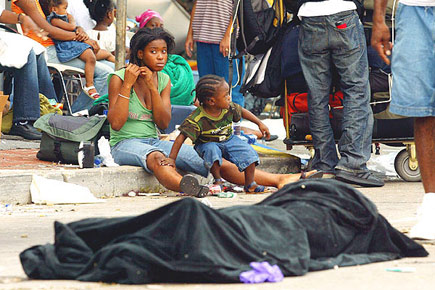 Hungry New Orleans residents wait for rescue amidst corpses and garbage.
